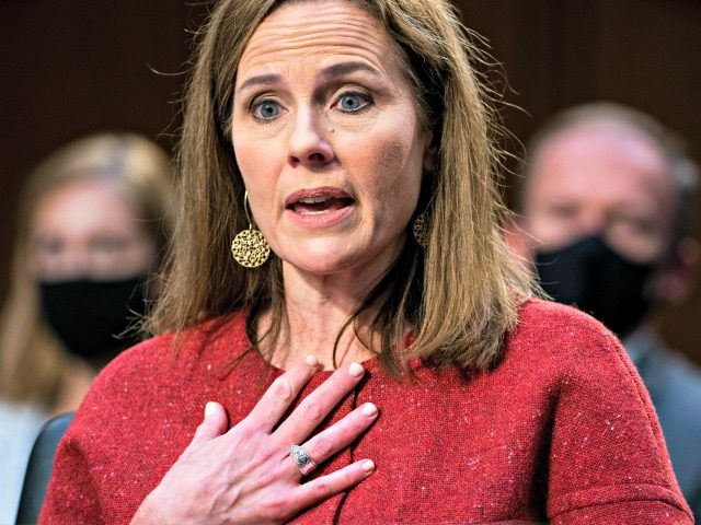 WASHINGTON, DC - OCTOBER 13: Supreme Court nominee Judge Amy Coney Barrett testifies before the Senate Judiciary Committee on the second day of her Supreme Court confirmation hearing on Capitol Hill on October 13, 2020 in Washington, DC. With less than a month until the presidential election, President Donald Trump …