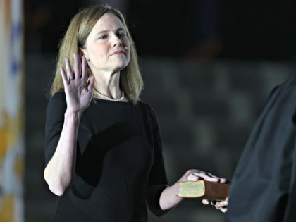 WASHINGTON, DC - OCTOBER 26: U.S. Supreme Court Associate Justice Amy Coney Barrett is sworn in by Supreme Court Associate Justice Clarence Thomas during a ceremonial swearing-in event on the South Lawn of the White House October 26, 2020 in Washington, DC. The Senate confirmed Barrett's nomination to the Supreme …