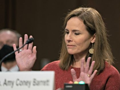 WASHINGTON, DC - OCTOBER 13: Supreme Court nominee Judge Amy Coney Barrett reacts while testifying before the Senate Judiciary Committee on the second day of her Supreme Court confirmation hearing on Capitol Hill on October 13, 2020 in Washington, DC. With less than a month until the presidential election, President …
