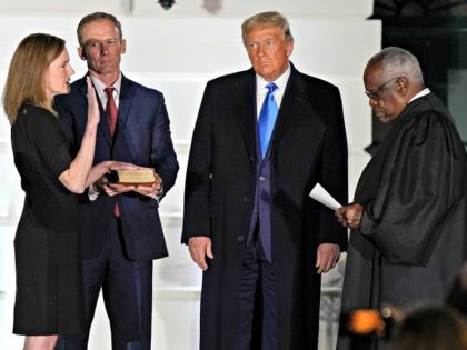 President Donald Trump watches as Supreme Court Justice Clarence Thomas administers the Constitutional Oath to Amy Coney Barrett on the South Lawn of the White House White House in Washington, Monday, Oct. 26, 2020, after Barrett was confirmed to be a Supreme Court justice by the Senate earlier in the …