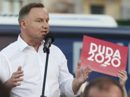 In this Tuesday, July 7, 2020 photo Poland's incumbent president Andrzej Duda, who is seeking reelection in a tight presidential election runoff on Sunday, July 12, 2020 attends a rally in Lomza, Poland. Duda, who has backing from Poland's ruling right-wing party, is running against liberal Warsaw mayor, Rafal Trzaskowski. …