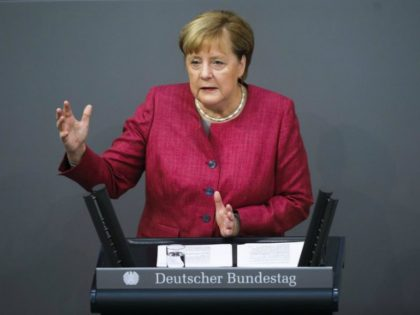 German Chancellor Angela Merkel delivers her speech during a debate about her policy as part of Germany's budget 2021 debate at the parliament Bundestag in Berlin, Germany, Wednesday, Sept. 30, 2020. (AP Photo/Markus Schreiber)