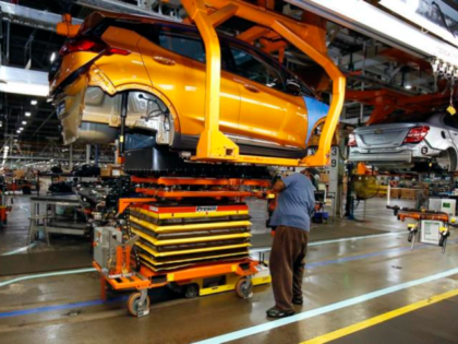 A battery is lifted into place for installation in the Chevrolet Bolt EV at the General Motors Orion Assembly plant Friday, Nov. 4, 2016, in Orion Township, Mich. The Chevrolet Bolt can go more than 200 miles on battery power and will cost less than the average new vehicle in …
