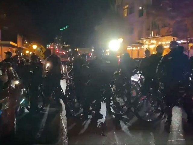 Protesters in black bloc take to streets of Seattle suburbs. (Twitter Video )Screenshot/Katie Daviscourt)