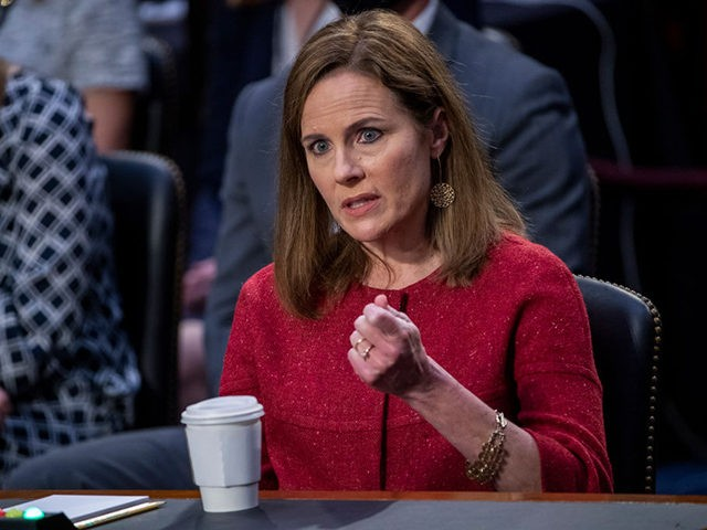 WASHINGTON, DC - OCTOBER 13: Supreme Court Justice nominee Judge Amy Coney Barrett responds to a question from Sen. Patrick Leahy (D-VT) on the second day of her Supreme Court confirmation hearings before the Senate Judiciary Committee on Capitol Hill on October 13, 2020 in Washington, DC. With less than …