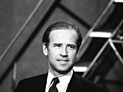 "Sen. Joseph Biden (D-Del.), smiles while talking with reporters shortly before his appearance on NBC's ""Meet the Press"" program in Washington, D.C., Sunday, April 29, 1984. The program was broadcast live at 12:30 p.m. EDT. (AP Photo/Charles Tasnadi)"