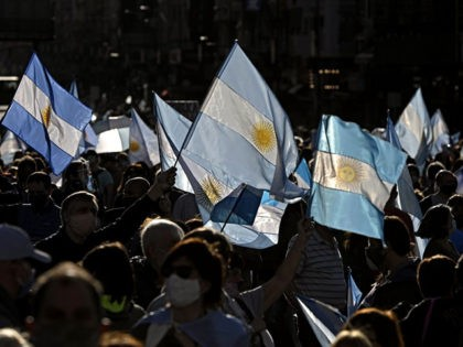 People take part in a protest against the government of Argentina's President Alberto Fernandez with Argentinian flags at Plaza de la Republica square in Buenos Aires on October 12, 2020, amid a lockdown against the spread of the COVID-19 coronavirus. - Thousands demonstrated again Monday in several cities of Argentina …