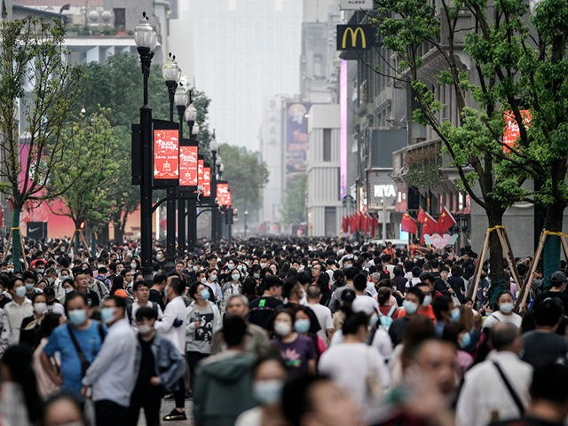 WUHAN, CHINA - OCTOBER 02: People tour in a shopping street during the national holiday on October 2, 2020 in Wuhan, Hubei province, China. China is celebrating its national day on October 1, marking the 71st anniversary of the founding of the People's Republic of China. As there have been …