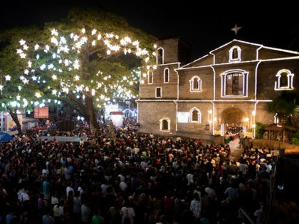 People attend the first of nine dawn masses signalling the official start of Christmas at Saint Joseph Parish in Manila on December 16, 2018. - The tradition of dawn masses dates back to the Spanish era and culminates on Christmas Eve and is a belief that anyone who completes the …