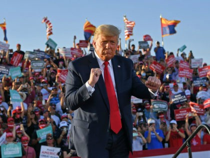 US President Donald Trump dances as he leaves a rally at Tucson International Airport in Tucson, Arizona on October 19, 2020. - US President Donald Trump went after top government scientist Anthony Fauci in a call with campaign staffers on October 19, 2020, suggesting the hugely respected and popular doctor …