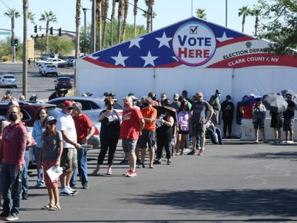 LAS VEGAS, NEVADA - OCTOBER 17: People line up to vote at a shopping center on the first day of in-person early voting on October 17, 2020 in Las Vegas, Nevada. Early voting for the general election in the battleground state continues through October 30. (Photo by Ethan Miller/Getty Images)