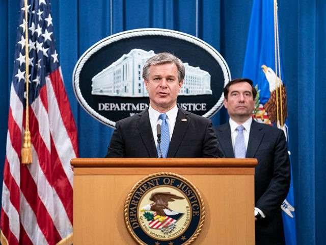 FBI Director Christopher Wray speaks during a virtual news conference at the Department of Justice on October 28, 2020 in Washington, DC. - Five Chinese agents have been arrested in the United States for their role in an operation targeting opponents of the Chinese government, US officials announced on October …