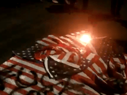 Flags stolen by protesters burned in New York streets during anti-police union march. (Twitter Video Screenshot/Dean Moss)
