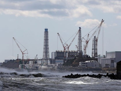 The Tokyo Electric Power Company's (TEPCO) Fukushima Daiichi nuclear power plant is seen from Futaba Town, Fukushima prefecture on March 11, 2020. - Japan marked the ninth anniversary of the killer tsunami that triggered the Fukushima nuclear meltdown, but fears about the new coronavirus forced a scaling back of public …