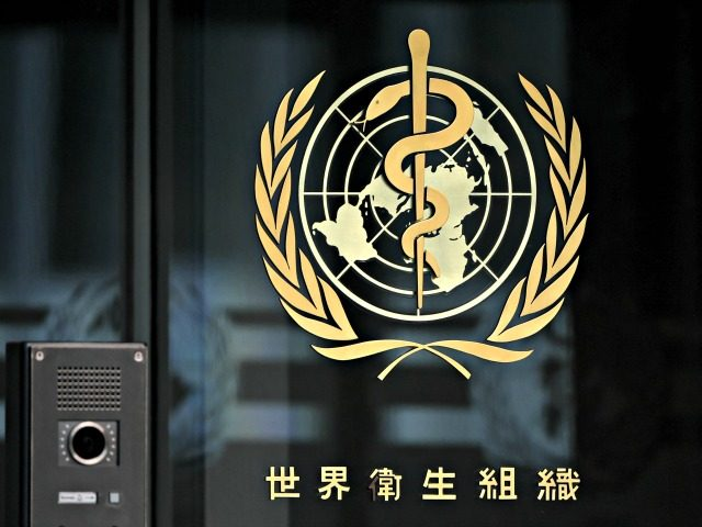 A photo taken in the late hours of August 17, 2020 shows a sign of the World Health Organization (WHO) written in Chinese at the entrance of their headquarters in Geneva amid the COVID-19 outbreak, caused by the novel coronavirus. (Photo by Fabrice COFFRINI / AFP) (Photo by FABRICE COFFRINI/AFP …