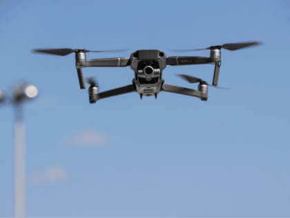 NEW YORK, NY - AUGUST 23: A new DJI Mavic Zoom drone flies during a product launch event at the Brooklyn Navy Yard, August 23, 2018 in New York City. DJI announced the release of two new drones, the Mavic 2 Pro and the Mavic 2 Zoom, which includes a …
