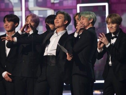 South Korean band BTS presents the award for Best R&B Album during the 61st Annual Grammy Awards on February 10, 2019, in Los Angeles. (Photo by Robyn Beck / AFP) (Photo credit should read ROBYN BECK/AFP via Getty Images)