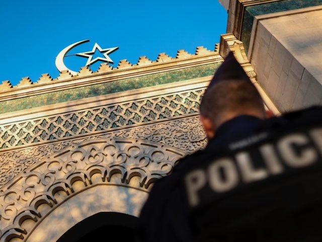 A French police officer stands guard in front of the entrance of the Grande Mosquee de Paris (Great Mosque of Paris) in Paris on March 22, 2019 during a tribute ceremony for the victims of the twin mosques massacres at Hagley Park in Christchurch. (Photo by KENZO TRIBOUILLARD / AFP) …