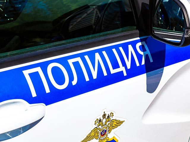 "Inscription ""Police"" on the board of russian police vehicle. Police patrol car in Russia"