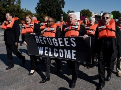 """Activists from Amnesty International , America's Voice, the Council on American-Islamic Relations (CAIR) and Church World Service (CWS) hold a civil disobedience protest against """"the decimation of the U.S. refugee resettlement program """" in front of the US Capitol on October 15, 2019 in Washington, DC. (Photo by Olivier Douliery …"""