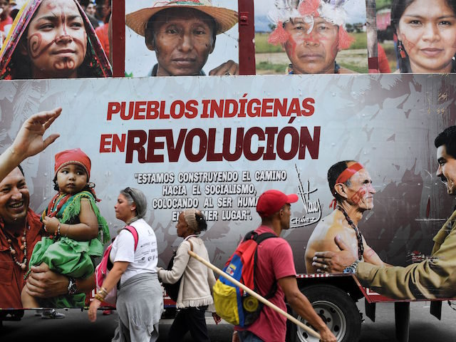 View of a sign during a march in solidarity with Ecuadorean indigenous in Caracas, Venezuela on October 15, 2019, following the agreement between indigenous leaders and Ecuador's President Lenin Moreno. (Photo by Yuri CORTEZ / AFP) (Photo by YURI CORTEZ/AFP via Getty Images)