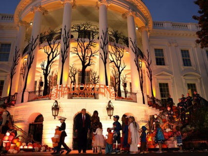 WASHINGTON, DC - OCTOBER 28: U.S. President Donald Trump and first lady Melania Trump hand out candy to children as they trick-or-treat during a Halloween at the White House event at the South Portico of the White House October 28, 2019 in Washington, DC. (Photo by Alex Wong/Getty Images)