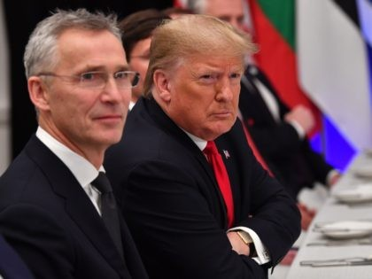 NATO Secretary General Jens Stoltenberg (L) looks on as US President Donald Trump gestures during a working lunch at the NATO summit at the Grove hotel in Watford, northeast of London on December 4, 2019. (Photo by Nicholas Kamm / AFP) (Photo by NICHOLAS KAMM/AFP via Getty Images)