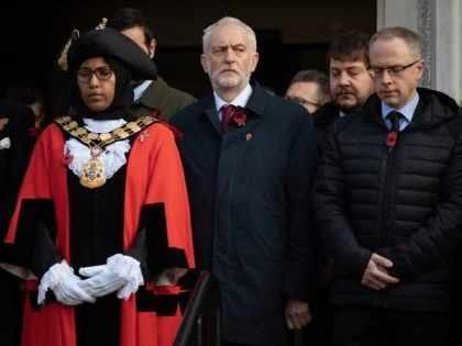LONDON, ENGLAND - NOVEMBER 11: Britain's Labour Party leader Jeremy Corbyn (C) stands with Islington Mayor Rakhia Ismail (L) as they attend the Armistice Day Commemoration at Islington Town Hall to mark Armistice Day on November 11, 2019 in London, England. (Photo by Leon Neal/Getty Images)