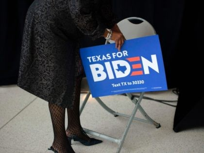 A supporter of presidential candidate Joe Biden waits for him to speak at a rally on March 2, 2020 at Texas Southern University in Houston, Texas. - Joe Biden's presidential hopes received a major campaign boost as fellow centrist Amy Klobuchar dropped out of the Democratic race and prepared to …