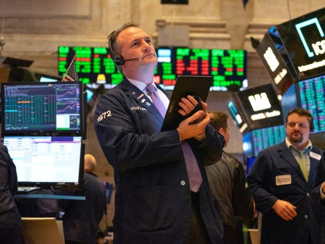 NEW YORK, NY - MARCH 04: Traders working the floor of the New York Stock Exchange (NYSE) on March 4, 2020 in New York City. Stocks soared as results of Joe Biden leads at Super Tuesday primary results Rebounds, stock closing at over 1,100 Points. (Photo by David Dee Delgado/Getty …