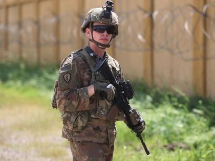 A US army soldier, part of the Combined Joint Task Force Operation Inherent Resolve (CJTF-OIR), the US-led coalition against the Islamic State (IS) group, stands on duty at the K1 airbase northwest of Kirkuk in northern Iraq on March 29, 2020, before a planned US forces pull-out. (Photo by AHMAD …
