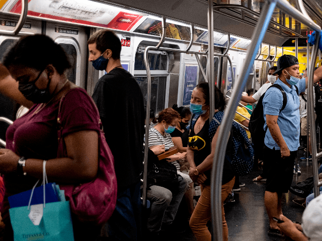 People stand in a subway train during rush hour amid the coronavirus pandemic on July 16, 2020 in New York City. (Photo by Johannes EISELE / AFP) (Photo by JOHANNES EISELE/AFP via Getty Images)