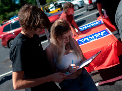 Catherine McDermott (R) registars to vote for the first time during a Republican voter registration in Brownsville, Pennsylvania on September 5, 2020. - Less than two months before the November 3 presidential election, the contrast between Republicans and Democrats is striking in Washington County, in the suburbs of Pittsburgh. (Photo …