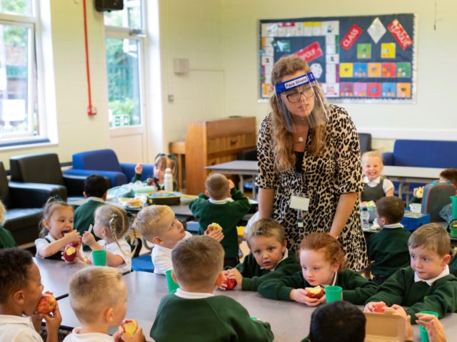 Reception children have their lunch at Woodlands Primary Academy in Oldham, northern England on September 7, 2020. - Millions of children across England have returned to school this week after the COVID-19 lockdown, with many schools introducing measures to enable as safe an environment as possible. Education Secretary Gavin Williamson …