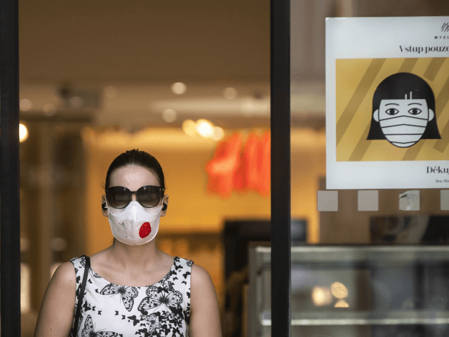 PRAGUE, CZECH REPUBLIC - SEPTEMBER 16: A woman wearing a face mask leaves the shopping mall on September 16, 2020, in Prague, Czech Republic. The Czech Republic records the highest increase of COVID-19 infected patients since the beginning of the pandemic of coronavirus spread, over 1000 daily. (Photo by Gabriel …