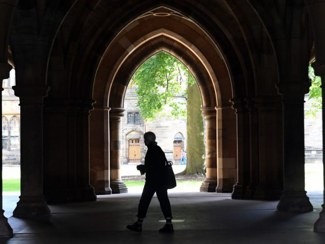 A student walks in the campus of Glasgow university complex, Glasgow, Scotland on September 24, 2020. - An outbreak of Covid-19 has led to 124 students testing positive at Glasgow University, with the university saying that 600 people were self-isolating. (Photo by Andy Buchanan / AFP) (Photo by ANDY BUCHANAN/AFP …