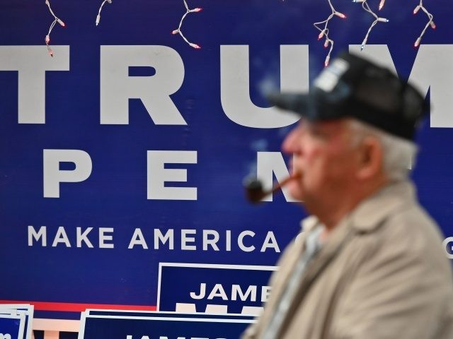 Trump supporter Tom Kenney smokes his pipe as he watches the first presidential debate between US President Donald Trump and Democratic presidential nominee and former Vice President Joe Biden on September 29, 2020 in Old Forge, near Scranton, Pennsylvania. (Photo by Angela Weiss / AFP) / The erroneous mention[s] appearing …