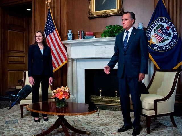 US Supreme Court nominee Amy Coney Barrett and Sen. Mitt Romney, R-UT, conduct a photo op in the US Capitol before Coney Barrett met with Senators throughout the day on September 30, 2020 in Washington,DC. (Photo by Tom Williams / POOL / AFP) (Photo by TOM WILLIAMS/POOL/AFP via Getty Images)