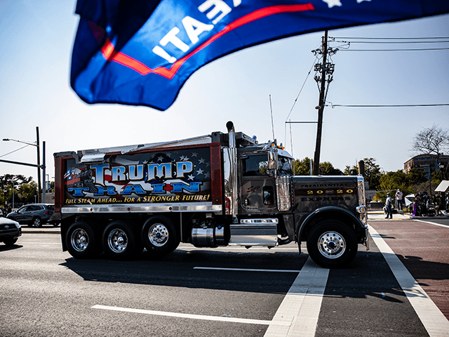 A dump truck decorated with Trump Train blows its horn as it drives past supporters of President Donald Trump outside of Walter Reed National Military Medical Center after the President was admitted for treatment of COVID-19 on October 4, 2020 in Bethesda, Maryland. The President announced via Twitter early Friday …