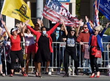 Supporters of US President Donald Trump show their support outside Walter Reed National Military Medical Center on October 5, 2020 in Bethesda, Maryland. - Donald Trump's doctors were to decide whether he is recovered enough to leave hospital and continue Covid-19 treatment at the White House, as the president signalled …