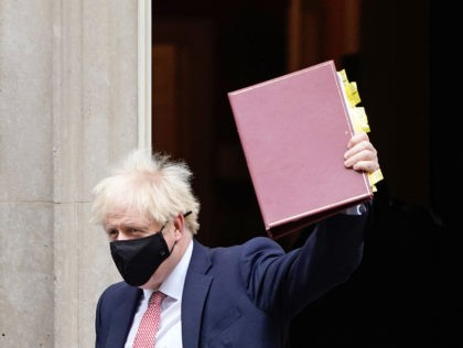 Britain's Prime Minister Boris Johnson, wearing a face covering due to the COVID-19 pandemic, leaves 10 Downing Street in central London on October 7, 2020, to attend the weekly session of Prime Minister's Questions (PMQs) at the House Commons. - Britain has suffered the worst death toll in Europe from …