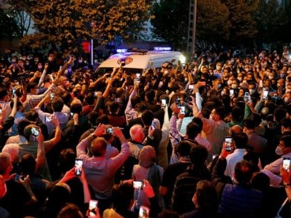 Fans of Iranian singer, instrumentalist and composer Mohammad-Reza Shajarian gather outside the Jam hospital in Tehran where he has died on October 8, 2020. - Singer, instrumentalist and composer Mohammad-Reza Shajarian, who died today aged 80, embodied traditional and classical Iranian music for more than half a century both at …