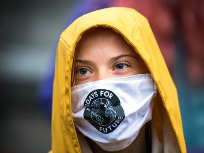 "Swedish climate activist Greta Thunberg is pictured during a ""Fridays for Future"" protest in front of the Swedish Parliament Riksdagen in Stockholm on October 9, 2020. (Photo by Jonathan NACKSTRAND / AFP) (Photo by JONATHAN NACKSTRAND/AFP via Getty Images)"