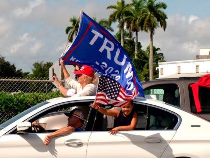 Supporters of President Donald Trump attend a mass caravan named 'Anticommunist Caravan' in Miami, Florida October 10, 2020. - Hundreds of cars participated October 10, 2020 in the anticommunist caravan organized by Cuban exiles in Miami. (Photo by GASTON DE CARDENAS / AFP) (Photo by GASTON DE CARDENAS/AFP via Getty …
