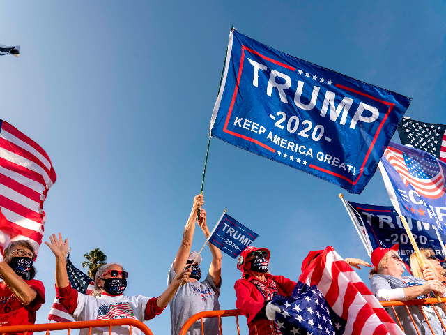 Supporters of US President Donald Trump hold signs and wave US national flags during a rally in Beverly Hills, California, October 10, 2020. (Photo by Kyle Grillot / AFP) (Photo by KYLE GRILLOT/AFP via Getty Images)
