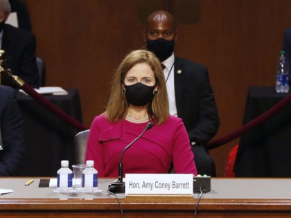 Amy Coney Barrett arrives for a confirmation hearing before the Senate Judiciary Committee, to become an Associate Justice of the US Supreme Court on Capitol, on Hill in Washington, DC on October 12, 2020. (Photo by SHAWN THEW / POOL / AFP) (Photo by SHAWN THEW/POOL/AFP via Getty Images)
