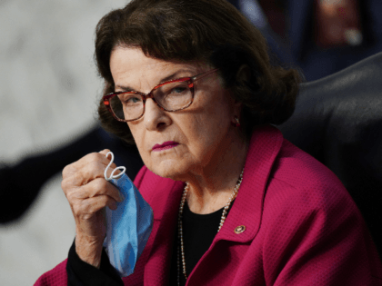 Ranking member Sen. Dianne Feinstein (D-CA) holds her facemask during the second day of the Senate Judiciary Committee Supreme Court confirmation hearing for Judge Amy Coney Barrett before the Senate Judiciary Committee, October 13, 2020, on Capitol Hill in Washington, DC. - President Donald Trump's US Supreme Court nominee Amy …