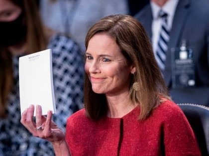 Judge Amy Coney Barrett, holds up a blank notepad after Senator John Cornyn asked her what documents she had on her desk during the second day of her Senate confirmation hearing to the Supreme Court on Capitol Hill in Washington, DC on October 13, 2020. - President Donald Trump's US …