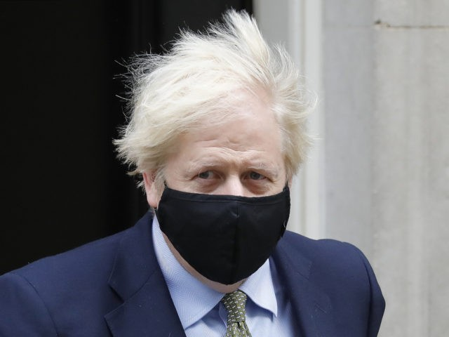 Britain's Prime Minister Boris Johnson, wearing a face mask or covering due to the COVID-19 pandemic, leaves number 10 Downing Street in central London on October 14, 2020, to take part in the Prime Minister Question (PMQs) session in the House of Commons. (Photo by Tolga AKMEN / AFP) (Photo …