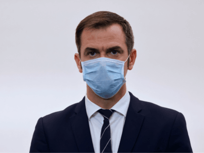 French Health Minister Olivier Veran wears a face mask during a press conference to present the details of new restrictions aimed at curbing the spread of the Covid-19 pandemic (novel coronavirus), announced the day before by the president, on October 15, 2020, in Paris. - France on October 14 became …